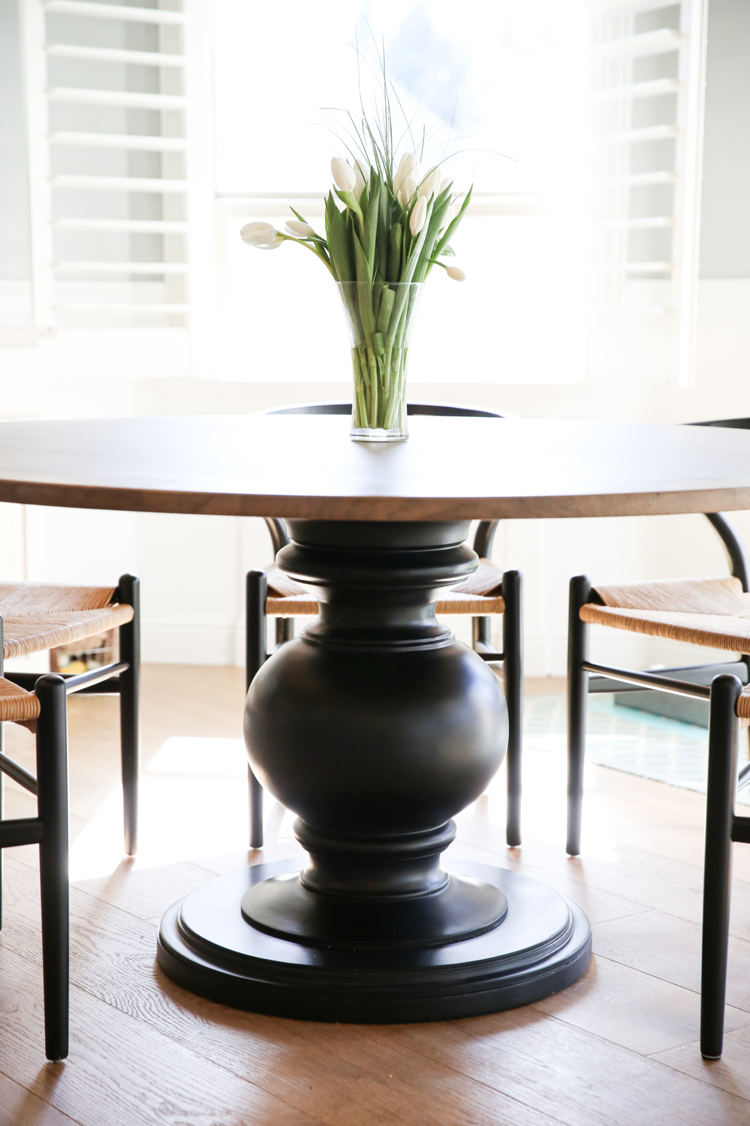 black pedestal table