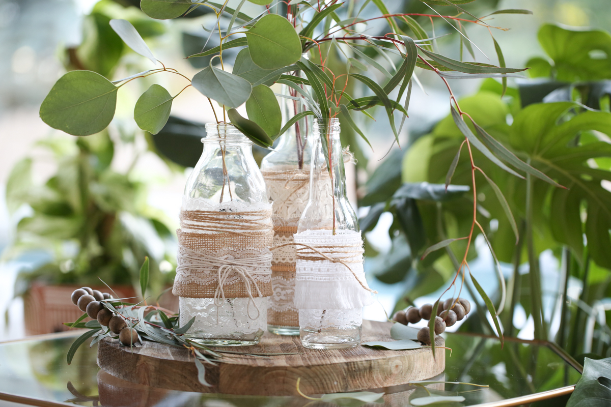lace and burlap decorated vases